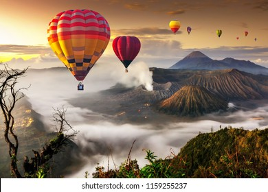 Colorful hot air balloons flying over Mount Bromo volcano in Bromo Tengger Semeru National Park, East Java, Indonesia.
