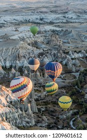 Colorful hot air balloons flying over Love Valley in Cappadocia, Turkey