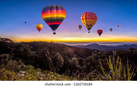 Colorful hot air balloons flying over mountain at Dot Inthanon in Chiang Mai, Thailand.