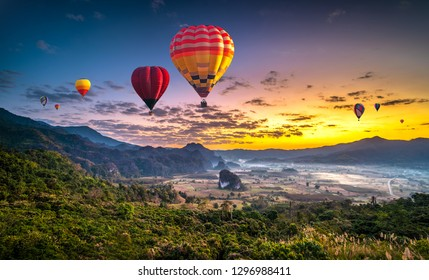 Colorful hot air balloons flying over mountain at Phu Langka national park, Phayao province in Thailand