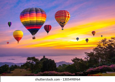 Colorful hot air balloons flying over mountain at Huai Nam Dang National park in sunrise and beautiful sky in morning, Chiang Mai, Thailand.