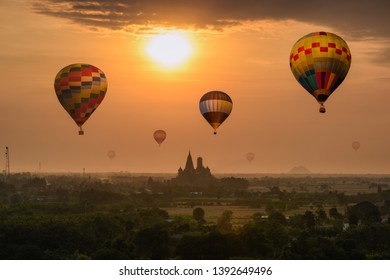 Colorful hot air balloons flying on Wat Tham Sua temple building on hill in sunrise morning. Kanchanaburi