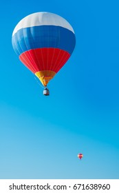Colorful hot air balloons flying in the blue sky. The first minute after takeoff. Balloon Festival — The Golden Ring Of Russia — Pereslavl Zalesskiy.