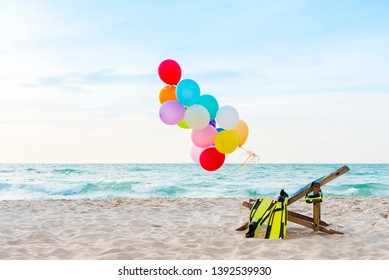 Colorful hot air balloons on tropical beach with free space. Travel and summer concept.