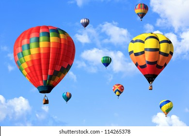 colorful hot air balloons over blue sky