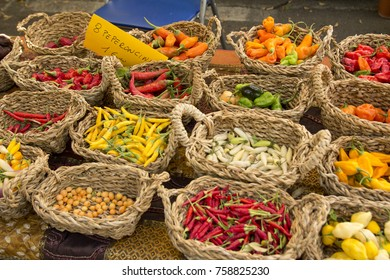 Colorful hot peppers in baskets at the street market.