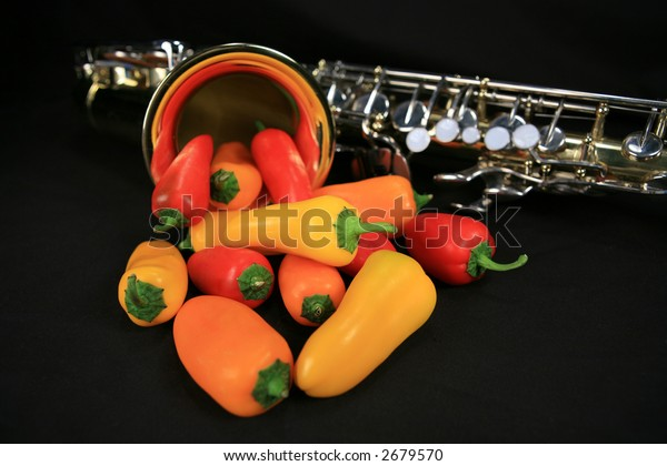 Colorful hot peppers coming out of alto saxophone Hot Sax