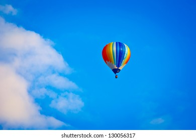 colorful hot-air balloon in blue sky