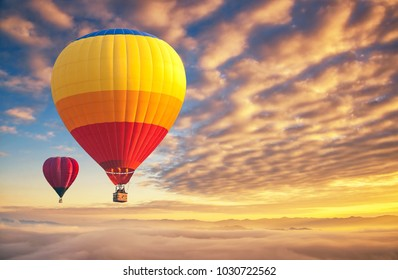 Colorful hot-air balloons flying over the cloud with sunset at Chiang Mai  sky in Thailand.