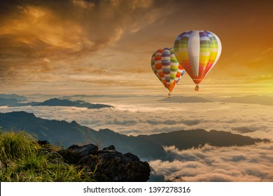 Colorful hot-air balloons flying over the mountain at Phucheefa,Chiangrai province ,North of Thailand.