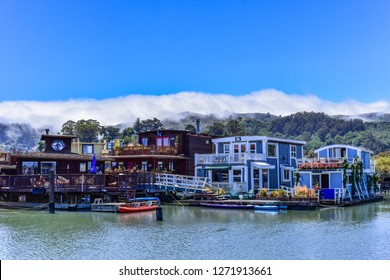 Colorful house boats floating on water on a sunny day in Sausalito, San Francisco bay, USA