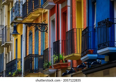 Colorful house facades and ornate metal balconies with flowers in the old town or Casco Viejo in Pamplona, Spain famous for running of the bulls