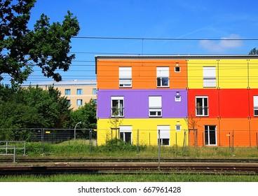 colorful house Germany, facade, blue sky, tree