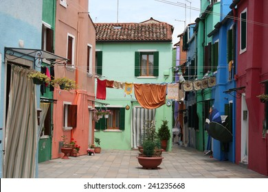 Colorful house with hanging washing, Venice Italy.