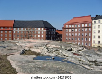 Colorful houses around the Temppeliaukio (Rock) Church in Helsinki, Finland