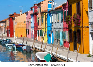 Colorful houses and boats in Burano, Venice Italy.