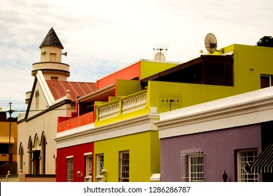 The colorful houses of Bo-Kaap, Cape Town. South African cityscape. The British style brightly colored buildings in the Muslim Malay Quarter, the former township. The famous historical site.