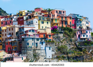 colorful houses built at a hill in Manarola, Cinque Terre, Italy