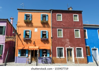 colorful houses of Burano Venice on sunny day