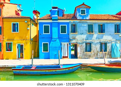 Colorful houses by canal in Burano, Venice, Italy