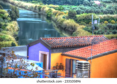 colorful houses by the river in Bosa, Italy. Processed for hdr tone mapping effect.