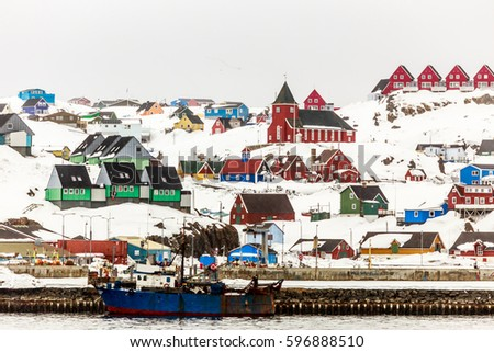 Colorful houses and church on the hill, Sisimiut town view from seaside, Greenland