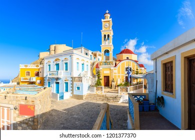 Colorful houses and church square in Olympos mountain village, Karpathos island, Greece