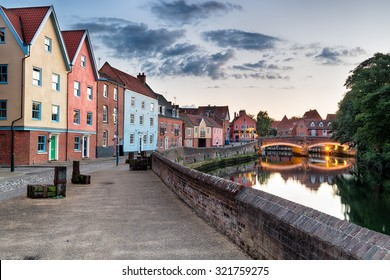 Colorful houses at dusk on the river Yare as it flows through the city of Norwich in Norfolk