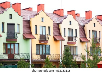 Colorful houses facades, pastel pale colors in Europe.
