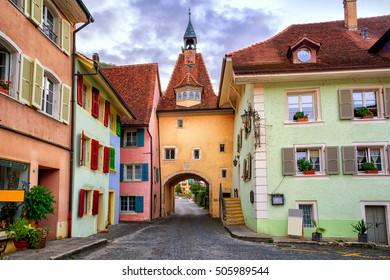 Colorful houses in the historical olt town St Ursanne, Kanton Jura, Switzerland