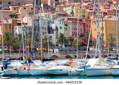 colorful houses of Menton with yachts in old town, France