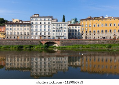 Colorful houses  are mirrored in riiver. Florence, Italy