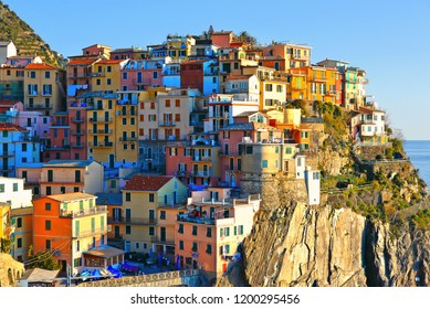 colorful houses and old facade in small village Manarola with mediterranean sea in background, Cinque terre, liguria , italy