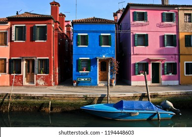 Colorful houses on the canal of island of Burano, Venice