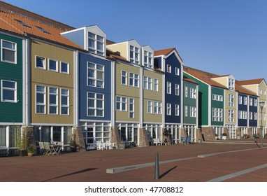 Colorful houses on the harbor quay off Hellevoetsluis, The Netherlands