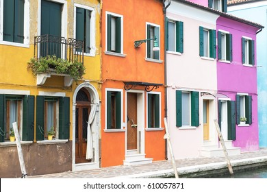 Colorful houses on the island named Burano (Venice, Italy). All potential trademarks are removed.