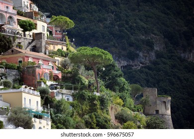 Colorful houses on steep hill with tower at Positano, Italy