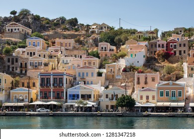 colorful houses at the port of Symi