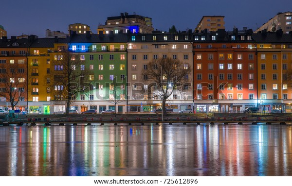 Colorful houses reflected by the frozen water. Kungsholmen, Stockholm, Sweden