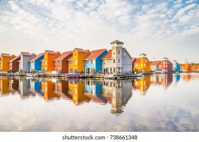 Colorful houses reflected in the water in Groningen in the Netherlands