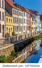 Colorful houses with reflection in the canal in Wismar, Germany