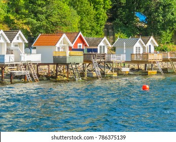 Colorful houses - as rorbu, is fisherman cabin, is a Norwegian traditional type of seasonal house, at the Oslo Fjord, Norway. Landscape of Norway fjord on summer day