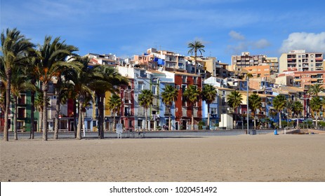 Colorful houses in seaside of Villajoyosa in Spain. Villajoyosa is located about 20 km south of Benidorm. With its fishermen's houses, the river Amadoria,sandy beaches and the promenade to the harbour