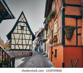 Colorful houses and street from medieval village Egusheim, Alsace, France