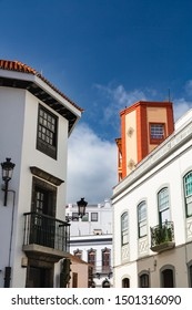 Colorful houses in the streets of Santa Cruz de La Palma, Spain, with blue sky.