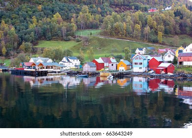 Colorful Houses in a waterfront village with nature along the shore of Sognefjord, Norway, Scandinavia