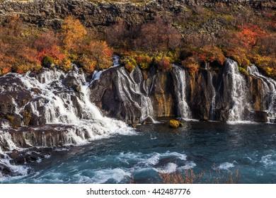 Colorful hraunfossar waterfall, Iceland. Wild autumn landscape