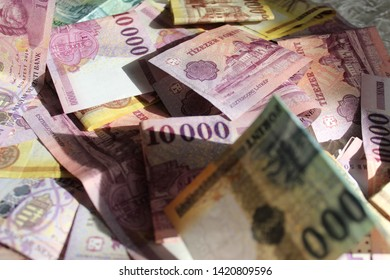 Colorful Hungarian forints are laying on the floor
