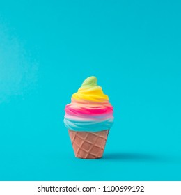 Colorful ice cream on pastel blue background. Creative minimal summer concept.