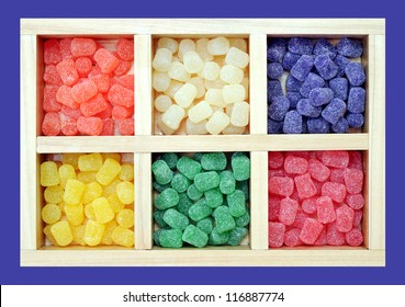 colorful icy gummy candies in grid tray